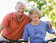 Photo of a man and woman on bicycles. Link to Life Stage Gift Planner Ages 60-70 Situations.